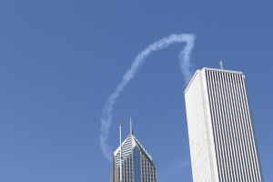 curved contrail two buildings