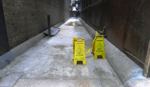 USE caution wet floor alley