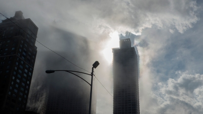 late afternoon fog buildings sun
